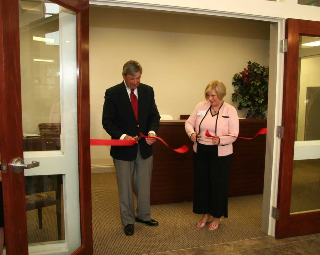Don and Kathy Cutting Ribbon